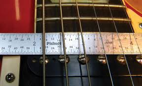 how to install a new tune o matic bridge premier guitar