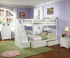 white stained pine wood bunk bed with narrow desk underneath which