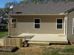 treated lumber floating deck with privacy panels planter box new