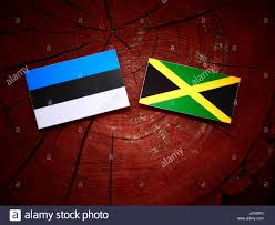 Estonian Flag Estonian Flag With Jamaican Flag On A Tree Stump Isolated Stock