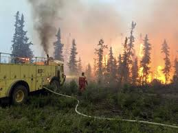 Wildfire Fighting Canada by Thousands Flee Wildfires Raging Across Western Canada The Globe