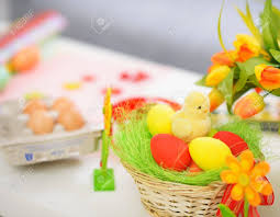 easter stuff closeup on table with easter eggs and decoration stuff stock photo