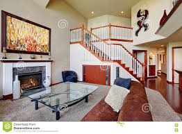 living room with vaulted ceiling american living room with high vaulted ceiling and staircase stock
