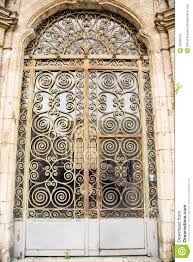 old glass doors old ornate scrollwork on door stock photo image 34636570