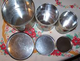 vintage metal kitchen canisters with geraniums