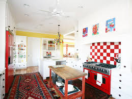 beautiful eclectic kitchen with red white tiled and backsplash