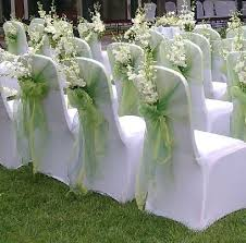 used wedding chair covers chair covers with flowers i like the idea of putting something