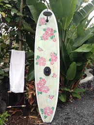 outdoor surfboard shower with hawaiian floral design stained