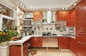 wooden furniture for kitchen kitchen interior with wooden furniture and many utensils in warm