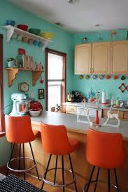 energizing orange kitchen design ideas chloeelan outstanding orange kitchen design with blue painting wall also bar stools idea plus simple shelves