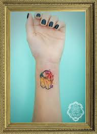 small watercolor tattoo by candelaria carballo tattoos