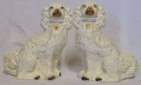 a pair of staffordshire pottery king charles spaniel mantle