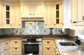 backsplash for cream cabinets traditional kitchen with cream colored cabinets and mirror