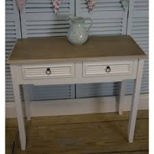 a pair of white vintage shabby chic two drawer bedside tables
