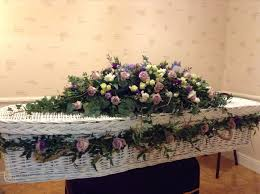 wicker casket white wicker coffin with a beautiful garland of lilac memory