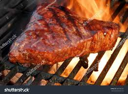 beef steak on bbq flaming charcoal stock photo 289728332