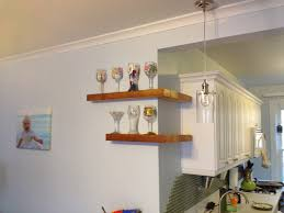 modern elegant design of the wooden kitchen wall shelves that can