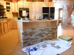 kitchen river rock shower floor backsplash tile wood backsplash