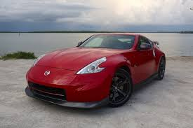 nissan red car nissan 370z nismo review track toy on a budget