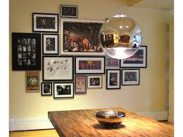 eclectic dining rooms arranging photos on a wall eclectic dining room by ilevel xfusionx