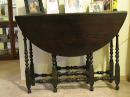 antique and vintage old oval gateleg drop leaf table with carving