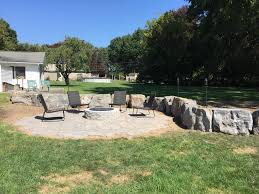backyard fire pit and dolomite wall