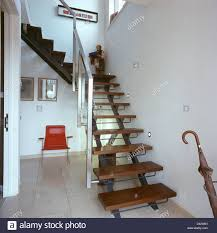 open wooden tread staircase with stainless steel banisters in