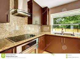 modern kitchen room with matte brown cabinets and granite trim