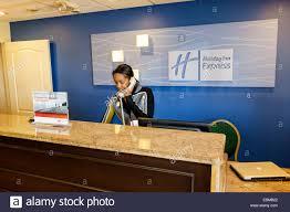clermont florida holiday inn express motel lobby front desk reception black woman employee job stock