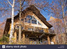 log home styles cottage style residential log home through trees in autumn quebec