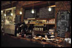 rustic interior cafe design with red bricks wallpaper interior