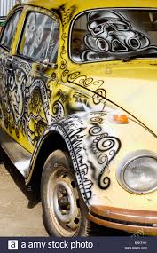 yellow volkswagen beetle royalty free a volkswagen beetle spray painted with graffiti art stock photo