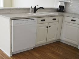 hickory wood nutmeg prestige door corner kitchen sink base cabinet