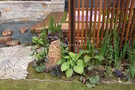 water feature deck with asian influence zen garden plant