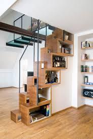interior unusual white bookshelves under white wooden staircase