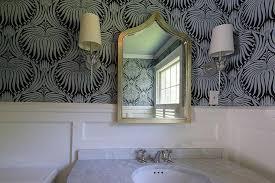 blue powder room with silver leaf moorish mirror transitional