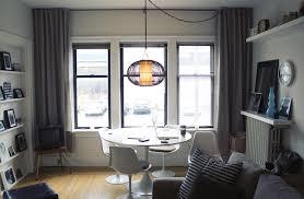 small studio apartment decor idea with white dining furniture also