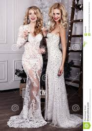 beautiful new years dresses beautiful women with chagne in celebrating new year stock