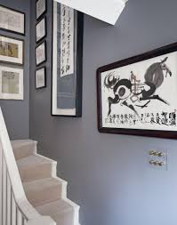 in a narrow hallway use steel grey paint as a dramatic backdrop
