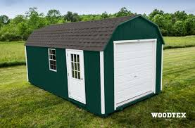 gambrel garage gambrel storage shed shown here in hunter green with white trim