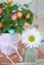 button flowers brighten your houseplants with diy button flowers town country