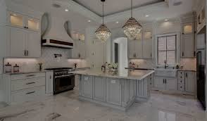 gray kitchen cabinets with white crown molding kith kitchens custom cabinetry high end cabinets