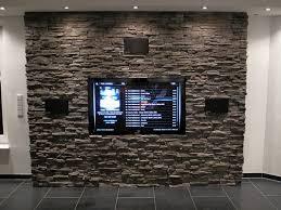 steinwand wohnzimmer tv tv natursteinwand rheumri