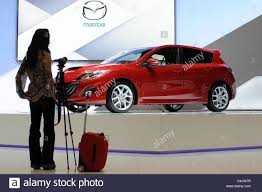 mazda international a woman stands in front of a mazda 3 mps on the second press day