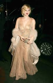 roaring 20 s fashion hair drew channels 20 s glamour with a fringed fur stole beaded dress