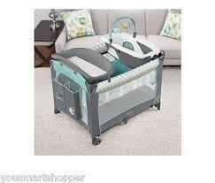 playard with dream center play portable bassinet travel crib