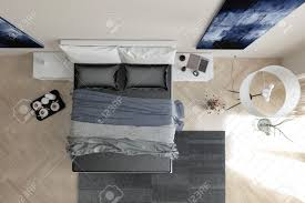 overhead view of modern grey and white bedroom interior with