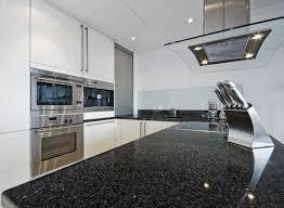 kitchen white pendant light white corner cabinets black granite