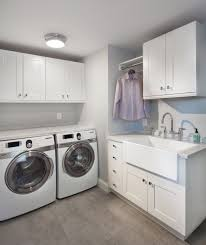 oversized hangers with transitional laundry room and apron sink