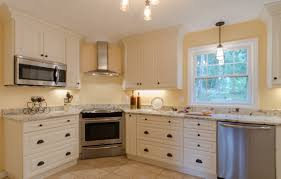 white cabinet kitchen corner range stainless appliances built